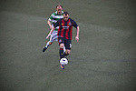 Bohemians forward Mark Quigley shields the ball from Scott Ruscoe at Park Hall Stadium, Oswestry during his team's Champions League 2nd qualifying round 2nd leg game away to The New Saints. Despite leading 1-0 from the first leg, the Dublin club went out following their 4-0 defeat by the Welsh champions. The match was the first-ever Champions League match in the UK played on an artificial pitch and was staged at the Welsh Premier League's ground which was located over the border in England.