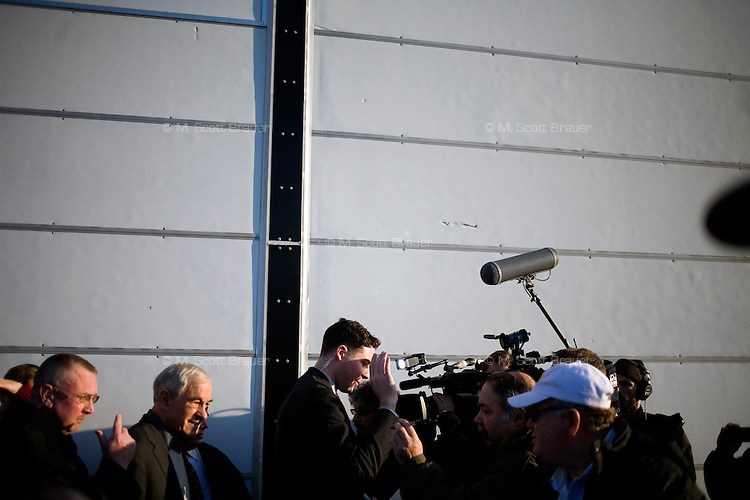 Members of the media and the public wait for congressman Ron Paul after a rally at Jet Aviation in Nashua, New Hampshire, on Jan. 6, 2012.  Paul is seeking the 2012 GOP Republican presidential nomination.