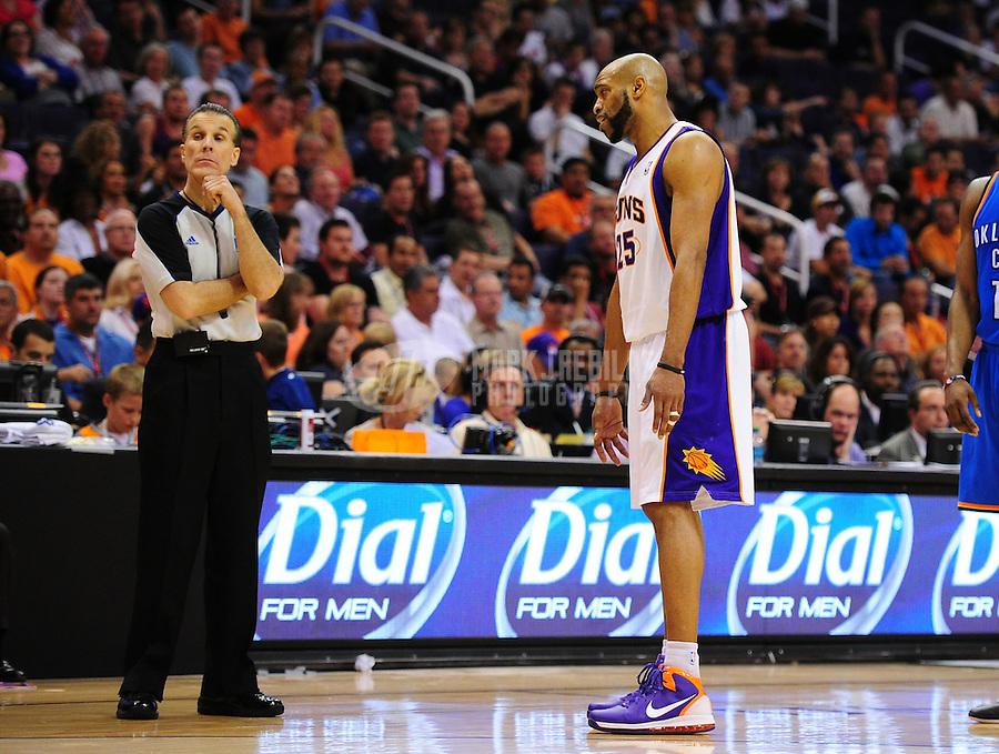 Mar. 30, 2011; Phoenix, AZ, USA; Phoenix Suns guard (25) Vince Carter argues with referee Ken Mauer against the Oklahoma City Thunder at the US Airways Center. Mandatory Credit: Mark J. Rebilas-.
