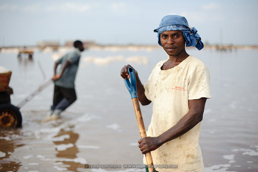 A worker in a salt pan at the Ada Songor Salt project.