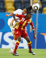 USA's Rachel Quon (L) and Deborah Afriyie of Ghana during the FIFA U20 Women's World Cup at the Rudolf Harbig Stadium in Dresden, Germany on July 14th, 2010.