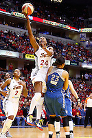INDIANAPOLIS, IN - OCTOBER 21: Tamika Catchings #24 of the Indiana Fever shoots over Maya Moore #23 of the Minnesota Lynx during Game Four of the 2012 WNBA Finals on October 21, 2012 at Bankers Life Fieldhouse in Indianapolis, Indiana. NOTE TO USER: User expressly acknowledges and agrees that, by downloading and or using this Photograph, user is consenting to the terms and conditions of the Getty Images License Agreement. (Photo by Michael Hickey/Getty Images) *** Local Caption *** Tamika Catchings; Maya Moore
