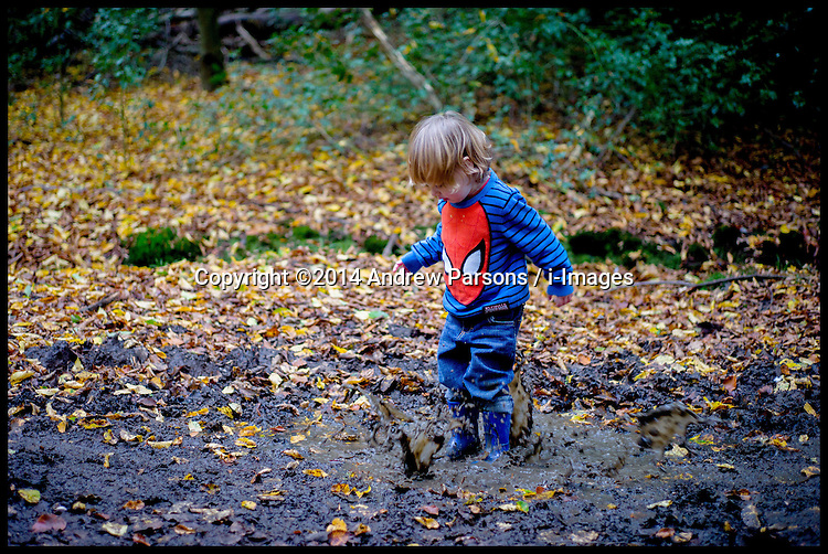 Image ©Licensed to i-Images Picture Agency. 26/10/2014. London, United Kingdom. Children playing in the muddy puddles in Epping  forest, Essex . Picture by Andrew Parsons / i-Images