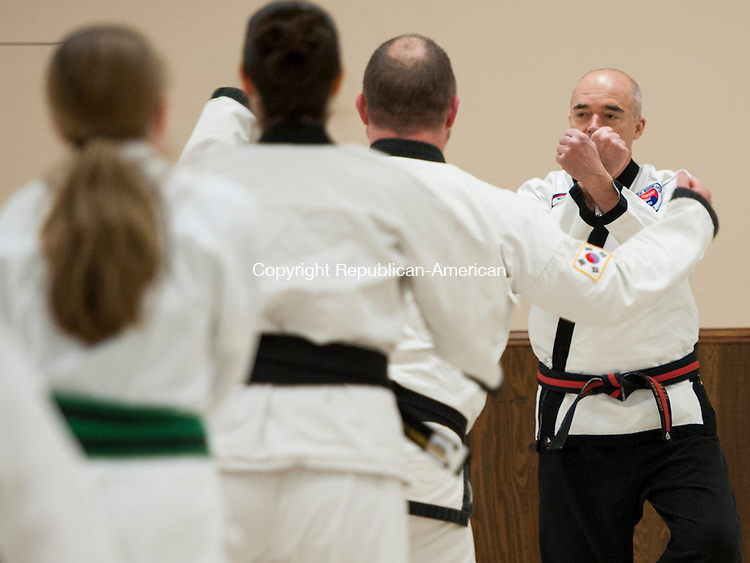BETHLEHEM, CT - 10 February 2014-021014EC02-   Karate instructor Doug Wilke demonstrates a pose to adult students Monday night at Memorial Hall in Bethlehem. The Park and Recreation Department is offering martial arts programs to students of all ages for the next ten weeks. Erin Covey Republican-American