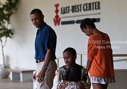 "United States President Barack Obama walks with daughters, Sasha, center, and Malia, right, after viewing an exhibit on the anthropological work of the president's late mother, Stanley Ann Dunham. It's called ""Through Her Eyes: Ann Dunham's Field Work in Indonesia.""  at the East-West Center in Honolulu, Hawaii, Sunday, Sunday, January 1, 2012. President Obama is in Hawaii with his family for a low-key vacation. .Credit: Kent Nishimura / Pool via CNP"