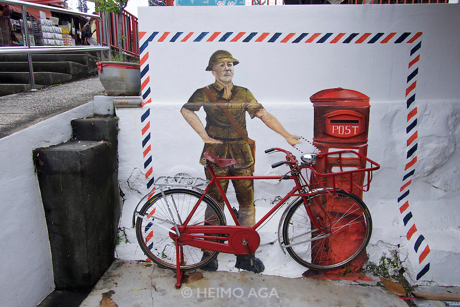 Malaysia, Penang. Snake Temple. Mural of a postman.