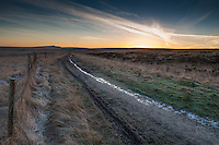 A view at sunrise towards Black Moss from a path between the Brun Clough and Redbrook Reservoirs on Saddleworth Moor.