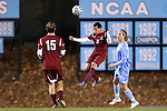 25 November 2012: FDU's Jaeffrey Barrenechea (2) heads the ball away from UNC's Andy Craven (right). The University of North Carolina Tar Heels played the Farleigh Dickinson Knights at Fetzer Field in Chapel Hill, North Carolina in a 2012 NCAA Division I Men's Soccer Tournament third round game. UNC won the game 1-0 in overtime.