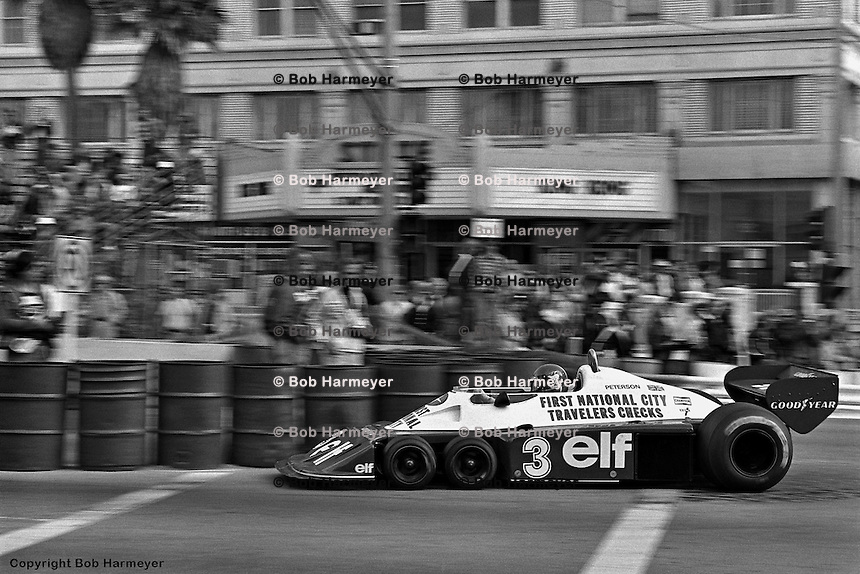 LONG BEACH, CA: Ronnie Peterson drives the Tyrrell P34 5/Ford Cosworth DFV through the final turn onto the pit straight during practice for the United States Grand Prix West on April 3, 1977, at the Long Beach street circuit in Long Beach, California.