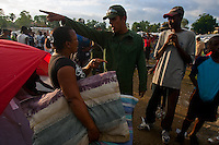 A woman protests a Venezuelan soldier's request to take down her tent to make way for larger, more sturdy ones in Jacmel's Pechinat camp for displaced persons. Though worried about privacy for her family, she eventually relented. The 7.0 earthquake that devastated parts of Haiti on January 12 killed hundreds of thousands of people. January's earthquake killed hundreds of thousands of people and caused significant and lasting structural and economic damage in the Caribbean nation.