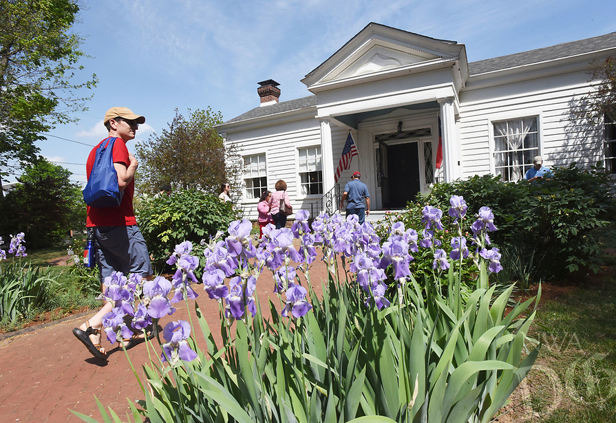 NWA Democrat-Gazette/FLIP PUTTHOFF <br /> BATTLE OF FAYETTEVILLE REMEMBERED<br /> Visitors enter Headquarters House on East Dickson Street on Saturday April 15 2017 during events commemorating The Battle of Fayetteville. Tours of the historic home were offered. Visitors also saw  artifact displays, heard Civil War era music and dance, saw cannon drills and a commemoration ceremony. The Battle of Fayetteville was fought April 18, 1863. Headquarters House served as a headquarters of Union and Confederate troops at different times during the Civil War.