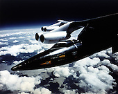1965 photo of the X-15 on the wing pilon of a B-52 in flight prior to launch.  This joint program by the National Aeronautics and Space Administration (NASA), the United States Air Force, the United States Navy, and North American Aviation, Inc. operated the most remarkable of all the rocket research aircraft. Composed of an internal structure of titanium and a skin surface of a chrome-nickel alloy known as Inconel X, the X-15 had its first, unpowered glide flight on June 8, 1959, while the first powered flight took place on September 17, 1959. Because of the large fuel consumption of its rocket engine, the X-15 was air launched from a B-52 aircraft at about 45,000 ft and speeds upward of 500 mph. The airplane first set speed records in the Mach 4-6 range with Mach 4.43 on March 7, 1961; Mach 5.27 on June 23, 1961; Mach 6.04 on November 9, 1961; and Mach 6.7 on October 3, 1967. It also set an altitude record of 354,200 feet (67 miles) on August 22, 1963, and provided an enormous wealth of data on hypersonic air flow, aerodynamic heating, control and stability at hypersonic speeds, reaction controls for flight above the atmosphere, piloting techniques for reentry, human factors, and flight instrumentation. The highly successful program contributed to the development of the Mercury, Gemini, and Apollo piloted spaceflight programs as well as the Space Shuttle program. The program's final flight was performed on October 24, 1968.
