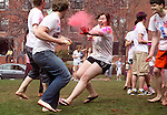 4/10/2011 -- Medford, MA -- Aspen Webster (Tufts '11) threw red powder at her friends, slipping on the wet grass in the process. (Kaveh Veyssi, A14, for Tufts University)