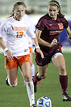 08 November 2013: Virginia's Shasta Fisher (12) and Virginia Tech's Murielle Tiernan (20). The University of Virginia Cavaliers played the Virginia Tech Hokies at WakeMed Stadium in Cary, North Carolina in a 2013 NCAA Division I Women's Soccer match and the semifinals of the Atlantic Coast Conference tournament. Virginia Tech won the game 4-2.