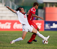 Keven Aleman (10) of Canada tries to tackle the ball away from Roberto Chen (5) of Panama during the semifinals of the CONCACAF Men's Under 17 Championship at Catherine Hall Stadium in Montego Bay, Jamaica. Canada defeated Panama, 1-0.