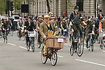 The Tweed Run, London UK. Cyclists ride around Parliament Square.