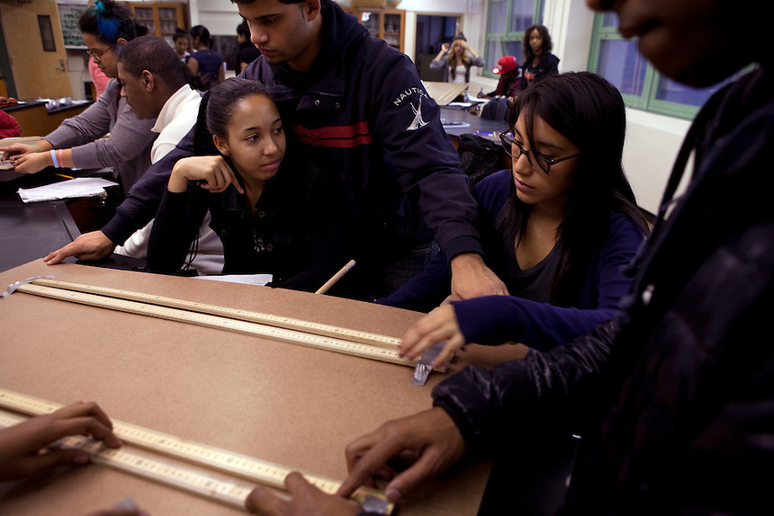 From left, Kayla Perdomo, 17, Derick Estrella, 17, Elvira Quintero, 17 and Eric Hamilton, 16, during Physics lab at Central Park East High School in New York, NY on November 15, 2012. Beyond sheer physical safety, a look at how schools and sitricts can create classroom conditions in which students are able to engage enthusiastically and without emotional fear of stepping forward. Photographer: Melanie Burford/Prime