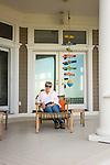 Woman on shorefront porch.