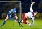 St Johnstone v Inverness Caledonian Thistle.....25.04.11.Lee Cox is upended by Murray Davidson.Picture by Graeme Hart..Copyright Perthshire Picture Agency.Tel: 01738 623350  Mobile: 07990 594431