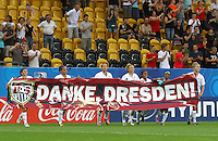 "USA's players with a banner (""Danke, Dresden"" - Thanks, Dresden) after winning the game against Switzerland 5:0 during the FIFA U20 Women's World Cup at the Rudolf Harbig Stadium in Dresden, Germany on July 17th, 2010."