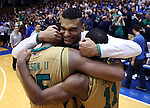 16 January 2016: Notre Dame's Bonzie Colson (35), Austin Torres (center), and Demetrius Jackson (11) embrace after the game. The Duke University Blue Devils hosted the University of Notre Dame Fighting Irish at Cameron Indoor Stadium in Durham, North Carolina in a 2015-16 NCAA Division I Men's Basketball game. Notre Dame won the game 95-91.