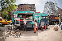 A truck promoting Boxed, a mobile app selling bulk items at wholesale prices is seen in Chelsea in New York on Thursday, May 28, 2015. Boxed startup recently raised $25 million in a Series B round of funding. The company imitates big box clubs such as Costco and Sam' Club but offers delivery. (© Richard B. Levine)