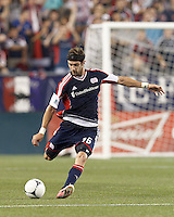 New England Revolution defender Stephen McCarthy (26) passes the ball. In a Major League Soccer (MLS) match, Montreal Impact defeated the New England Revolution, 1-0, at Gillette Stadium on August 12, 2012.