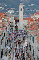 Stradun or Placa, the main street in the Old Town, with the bell tower behind, Dubrovnik, Croatia. The street is 300m long and paved in limestone. The city developed as an important port in the 15th and 16th centuries and has had a multicultural history, allied to the Romans, Ostrogoths, Byzantines, Ancona, Hungary and the Ottomans. In 1979 the city was listed as a UNESCO World Heritage Site. Picture by Manuel Cohen