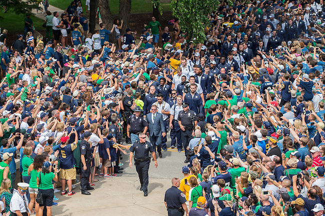 Aug. 30, 2014; The football team walks to the stadium..Photo by Matt Cashore/University of Notre Dame