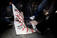 Visitors to the Nanjing Massacre Memorial Museum in Nanjing, Jiangsu, China, step on a hand-made Japanese Imperial flag on the 71st anniversary of the Nanjing Massacre.