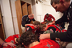 Players for the Hoxie High School Indians kneel in prayer before their homecoming game in Hoxie, Kan. on Friday, Oct. 12, 2012. Parents and community members say that many graduating seniors are opting to either stay home after graduation or return home to work on their family farms after college because of a healthy local economy job opportunities in the agricultural sector. As historically dry conditions continue, farmers from South Dakota to the Texas panhandle rely on the Ogallala Aquifer, the largest underground aquifer in the United States, to irrigate crops. After decades of use, the falling water level ? accelerated by historic drought conditions over the last two years ? is putting pressure on farmers to ease usage or risk becoming the last generation to grow crops on the land. Farmers like Mitchell Baalman and Brett Oelke (both not pictured) are part of a farming community in in Sheridan County, Kansas, an agricultural hub in western Kansas, who have agreed to cut back on water use for crop irrigation so that their children and future generations can continue to farm and sustain themselves on the High Plains.