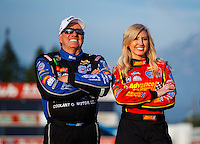 Feb 8, 2017; Pomona, CA, USA; NHRA funny car driver John Force (left) and daughter Courtney Force during media day at Auto Club Raceway at Pomona. Mandatory Credit: Mark J. Rebilas-USA TODAY Sports