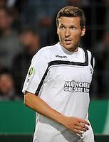 FUSSBALL   DFB POKAL   SAISON 2011/2012  1. Hauptrunde VfL Osnabrueck - TSV 1860 Muenchen                29.07.2011 Benjamin LAUTH (1860 Muenchen) fixiert den Ball