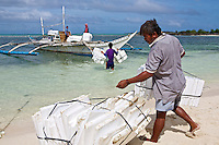 Victor picking up styrofoam used to float seaweed lines. These goods were send to Panagatan where a lot of lines and floats where washed away during Typhoon Yolanda (Haiyan).