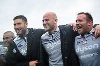 Matt Banahan, Matt Garvey and Henry Thomas of Bath Rugby are all smiles in a post-match huddle. Aviva Premiership match, between Northampton Saints and Bath Rugby on September 3, 2016 at Franklin's Gardens in Northampton, England. Photo by: Patrick Khachfe / Onside Images
