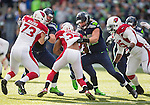 Seattle Seahawks right tackle Justin Britt (68) and tight end Luke Willson (82) blocks Arizona Cardinals  defensive end Josh Mauro (73) and cornerback Antionio Comartie (31)at CenturyLink Field in Seattle, Washington on November 23, 2014. The Seahawks beat the Cardinals 19-3.   ©2014. Jim Bryant Photo. All Rights Reserved.
