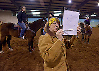 NWA Democrat-Gazette/BEN GOFF -- 02/01/15 Kelly Morris, director of the Rodeo of the Ozarks Rounders, coaches the high-speed precision drill team during their weekly practice in Isuba Valley Horse Park near Siloam Springs on Sunday, Feb. 1, 2015.