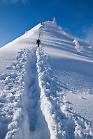 Person Climbs through deep powder snow towars summit of Jenner, Berchtesgaden national park, Bavaria, Germany