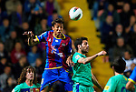 Levante's Botelho (L) vies for the ball with FC Barcelona's Fabregas (R) during the Spanish league football match Levante UD vs FC Barcelona on April 14, 2012 at the Ciudad de Valencia Stadium in Valencia. (Photo by Xaume Olleros/Action Plus)