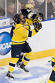 Karl Stollery (Merrimack - 7), Calle Ridderwall (Notre Dame - 22) - The University of Notre Dame Fighting Irish defeated the Merrimack College Warriors 4-3 in overtime in their NCAA Northeast Regional Semi-Final on Saturday, March 26, 2011, at Verizon Wireless Arena in Manchester, New Hampshire.