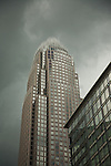 Bank Of America Building as an approaching storm blows in from the other side.