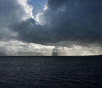 Dramatic light over mountains of Vesterålen as viewed from ferry