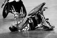 Cristian Amaya, a Colombian disabled athlete, tips over during a wheelchair rugby training match at the indoor sporting arena in Bogota, Colombia, 29 January 2013. Wheelchair rugby, a full-contact team sport, was developed in Canada in 1977 under the name murderball. The game is played only by athletes with some form of disability in both the upper and lower limbs (quadriplegics). Attempting to score by carrying the ball across the goal line, four players from each team roughly crash into each other in specially designed armored wheelchairs. Although the team from Bogota is supported by a foundation (gear), quad rugby players, mostly coming from the remote, socially deprived neighbourhoods, often can not attend a training due to lack of funds for transportation. However, they still dream of representing Colombia at Rio 2016 Paralympic Games.