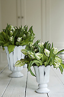 White vases filled with parrot tulips decorate the trestle table in the breakfast room