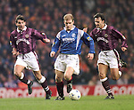 Gordon Durie with Hearts defenders Neil Pointon and Graeme Hogg in hot pursuit