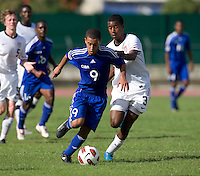 Kellyn Kai Perry-Acosta (3) of the United States tries to take the ball away from Dairon Perez (9) of Cuba during the first day of the group stage at the CONCACAF Men's Under 17 Championship at Catherine Hall Stadium in Montego Bay, Jamaica. The United States defeated Cuba, 3-1.