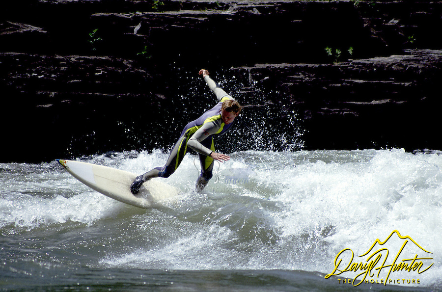 Surfing Lunch Counter Rapid on the Snake River in Jackson Hole, Wyoming.