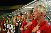 The United States' head coach, Thomas Rongen, and his coaching staff salute from the bench during the playing of the US National Anthem before the match against South Korea during the FIFA Under 20 World Cup Group C match between the United States and South Korea at the Mubarak Stadium on October 02, 2009 in Suez, Egypt.