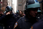 New York, New York<br /> November 17, 2011<br /> <br /> &quot;Occupy Wall Street&quot; protesters mark the movement's two-month milestone by marching from Zuccotti Park, in mass, to various access streets surrounding the New York Stock Exchange, which the police had barricaded off. Yet instead of the police keeping protesters out, protesters locked down those entrances to Wall Street and the New York Stock Exchange creating havoc as the police made more then 240 arrests to try and keep the streets open to normal traffic.<br /> <br /> An anti-Wall Street protester is arrested on Broadway just in front of a Chase Manhattan entrance.
