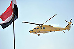 A helicopter carries Egyptian President Abdel-Fattah el-Sissi after the funeral of Prosecutor General Hisham Barakat, killed in a bomb attack a day earlier, outside the Field Marshal Mohammed Hussein Tantawi Mosque in Cairo, Egypt, Tuesday, June 30, 2015. Heavy security forces deployed across the Egyptian capital for the burial of Barakat, the top judicial official in charge of overseeing prosecution of thousands of Islamists. Photo by Amr Sayed